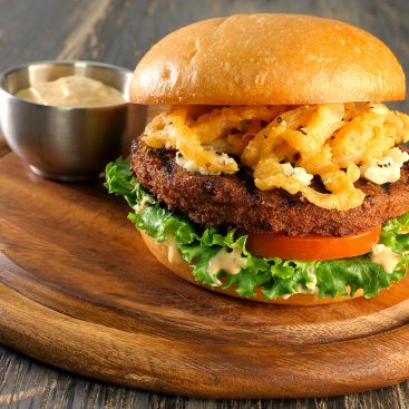Plant-based burger on a bun with fried onions